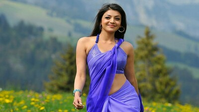 Actress Kajal Aggarwal in Purple Saree