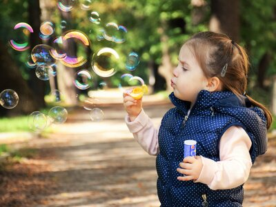 Beauty Kid Playing with Bubbles