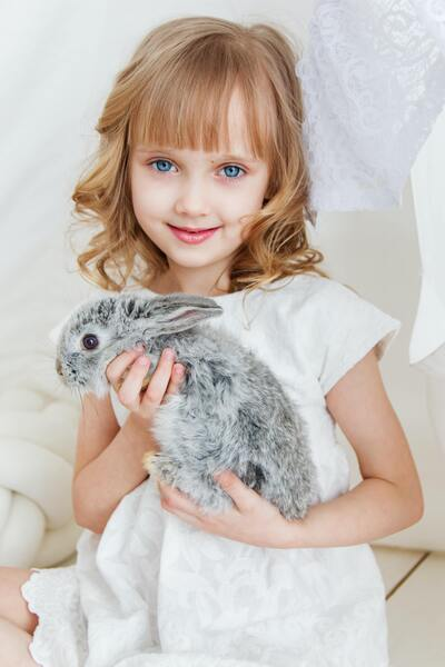 Cute Baby Girl With Rabbit
