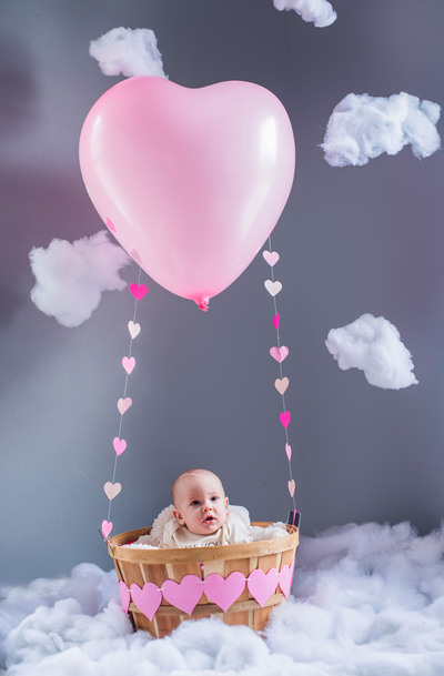 Cute Baby in Balloon Parachute