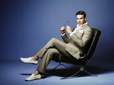 Elegant Akshay Kumar Sitting On A Chair