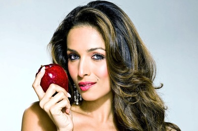 Heroine Malaika Arora With an Apple