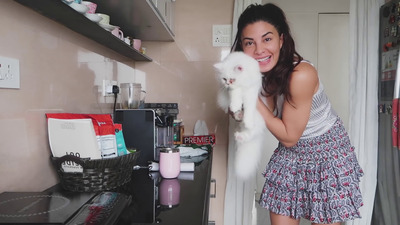 Jaqualine Fernandez with Cat at Home Photo