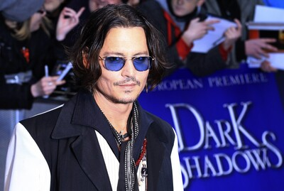 Johnny Depp At Red Carpet with Blue Sunglasses