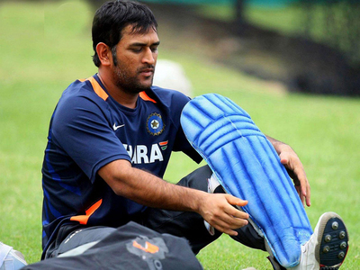 MS Dhoni Tying Pads On Ground