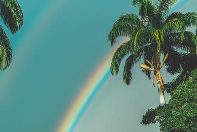 Rainbow on Beach Ultra HD Wallpaper