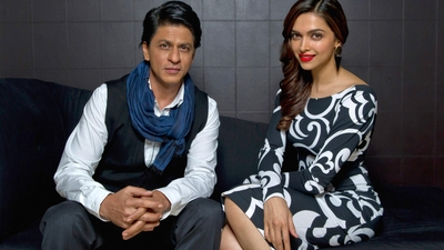 Shahrukh Khan And Deepika Padukone Sitting on Couch