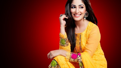 Smiling Yami Gautam In Yellow Dress