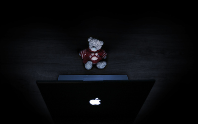 Teddy Bear in Front of Mac Laptop