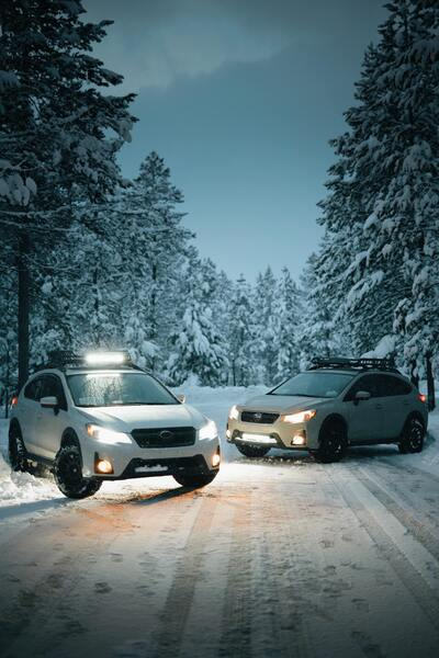 Two White Subaru Suvs Car on Snow Covered Road
