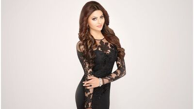 Urvashi Rautela in Black One Piece