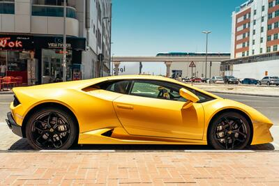 Yellow Lamborghini Parked Beside Road 4K